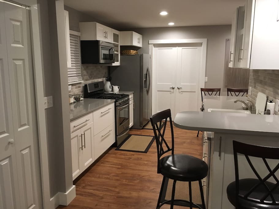 The kitchen has an eating area at each end of the counter.