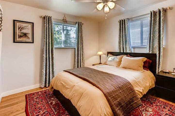Large guest room with queen bed & work space