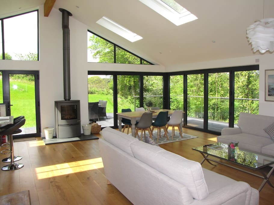 Sitting room with Bi Folds opening onto deck and garden. Wood burner for cosy winter nights.