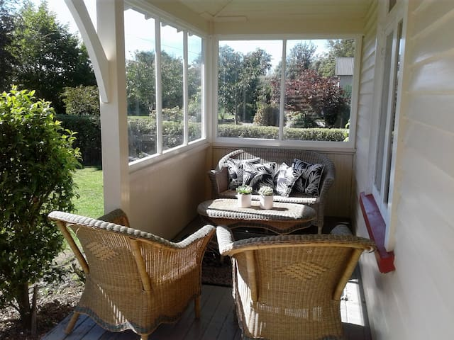 Sunny porch with outdoor furniture