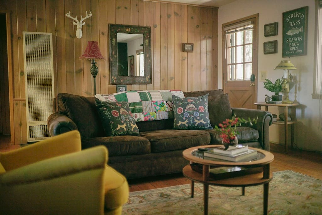 Original wood paneled walls and beautiful pine floors.