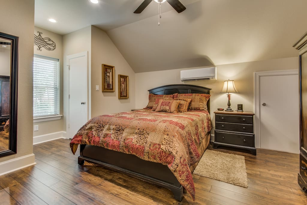 Bedroom with queen size bed, walk in closet and TV provided