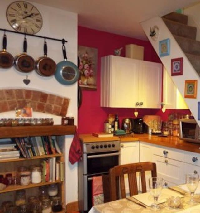 The kitchen, stocked with spices and baking ingredients, coffee maker and tassimo coffee pods at 40p each.