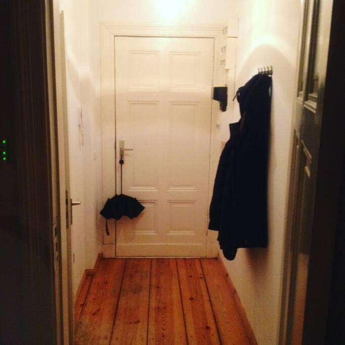little hallway with coat hangers