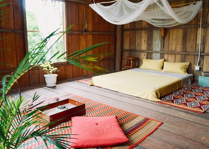 Zen style room in wooden Khmer house