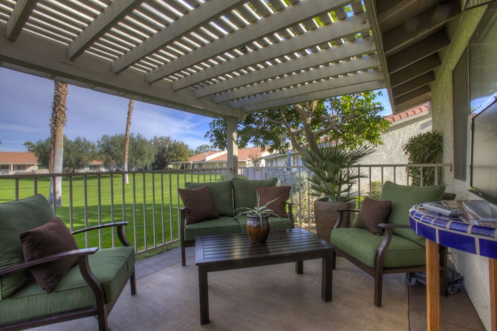 Relax outside on your private patio overlooking the pool and grounds