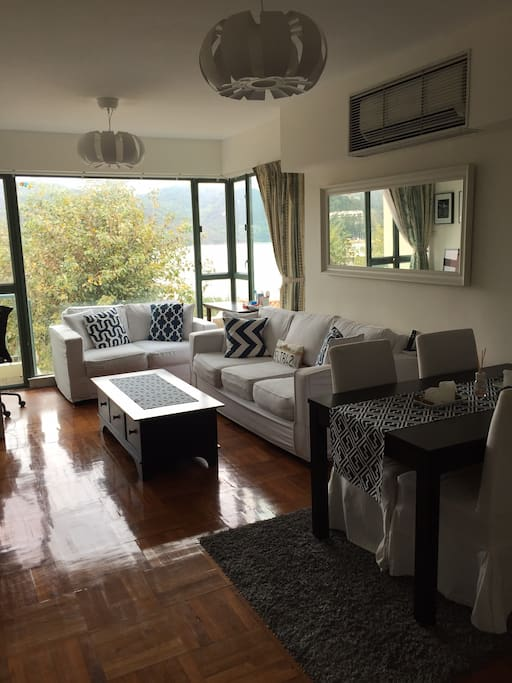 Bright and spacious living room with fabulous view of Discovery Bay