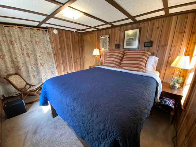 Master bedroom with a queen bed, just off hallway next to full bath.