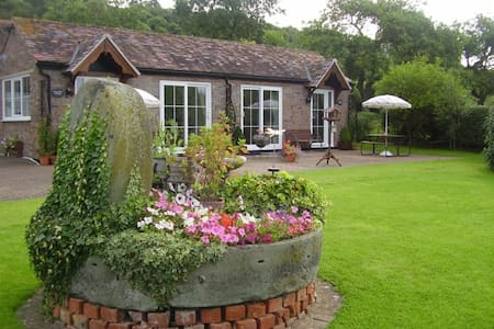Dovecote Cottage is set within beautiful gardens.