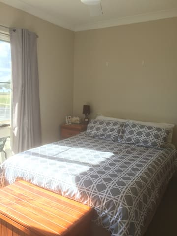 Master bedroom with Queen bed and balcony - views over the Hastings River.