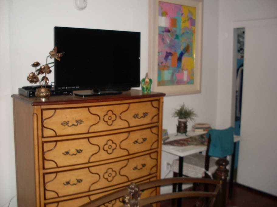 Clothing drawer, HDTV, table, chair and my artwork