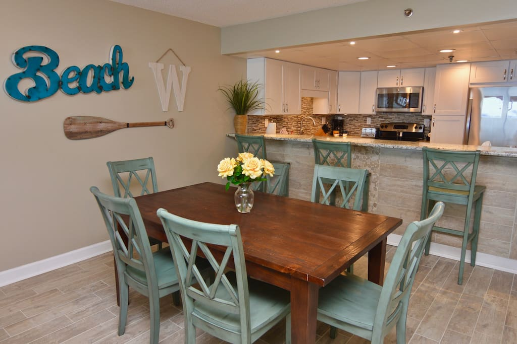 Dining room and breakfast bar into kitchen.