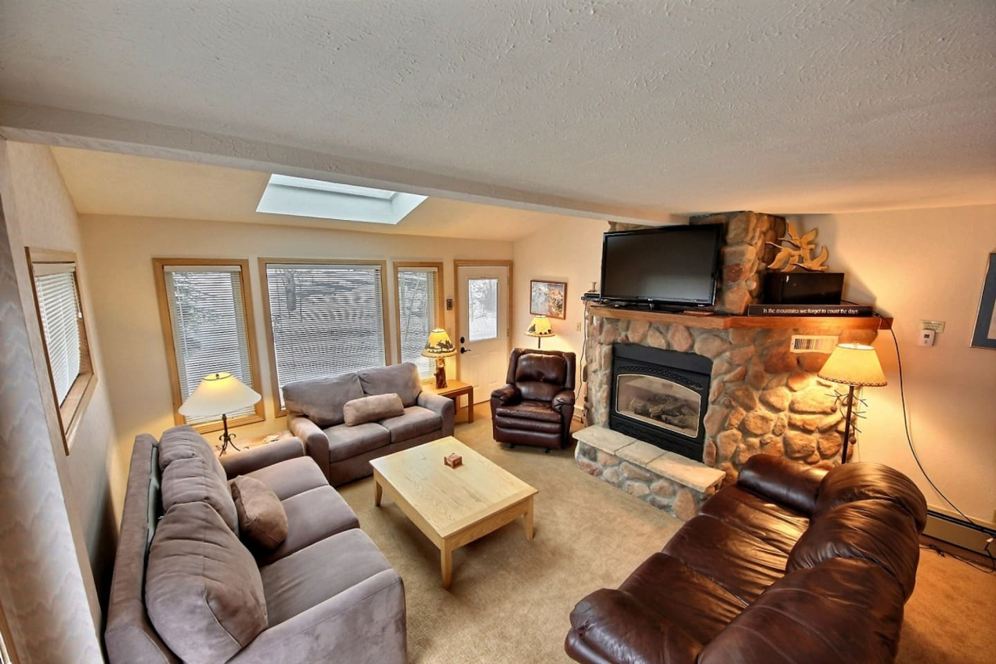Ample, cushy seating around TV and fireplace!