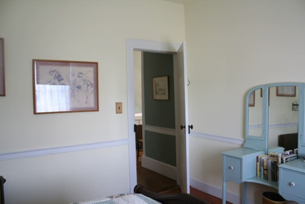 Door to the hallway and upstairs bathroom