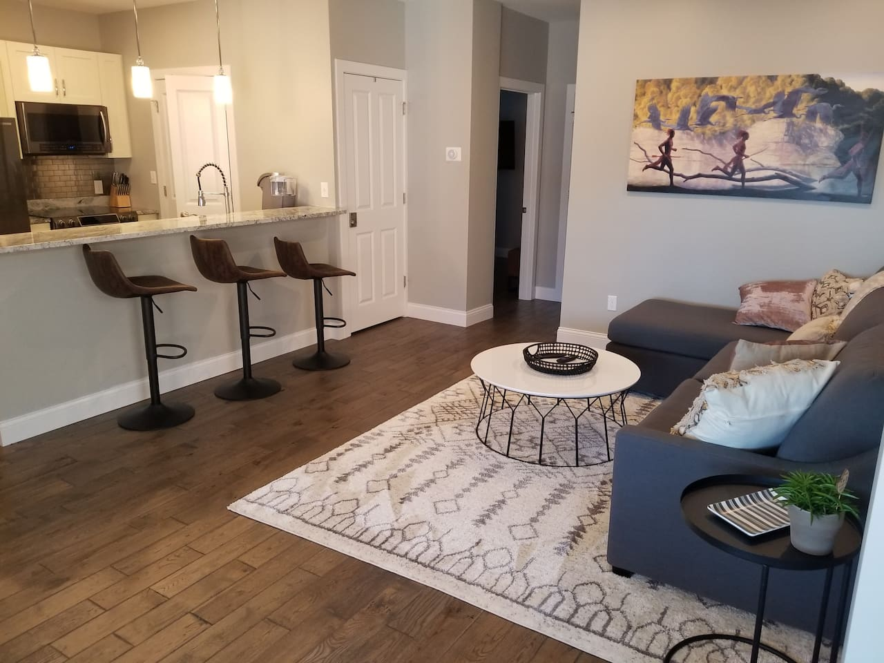 Large open concept living area. Art provided by Bryan Haynes.