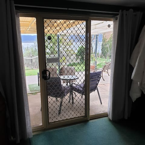 Looking out to undercover area from bedroom