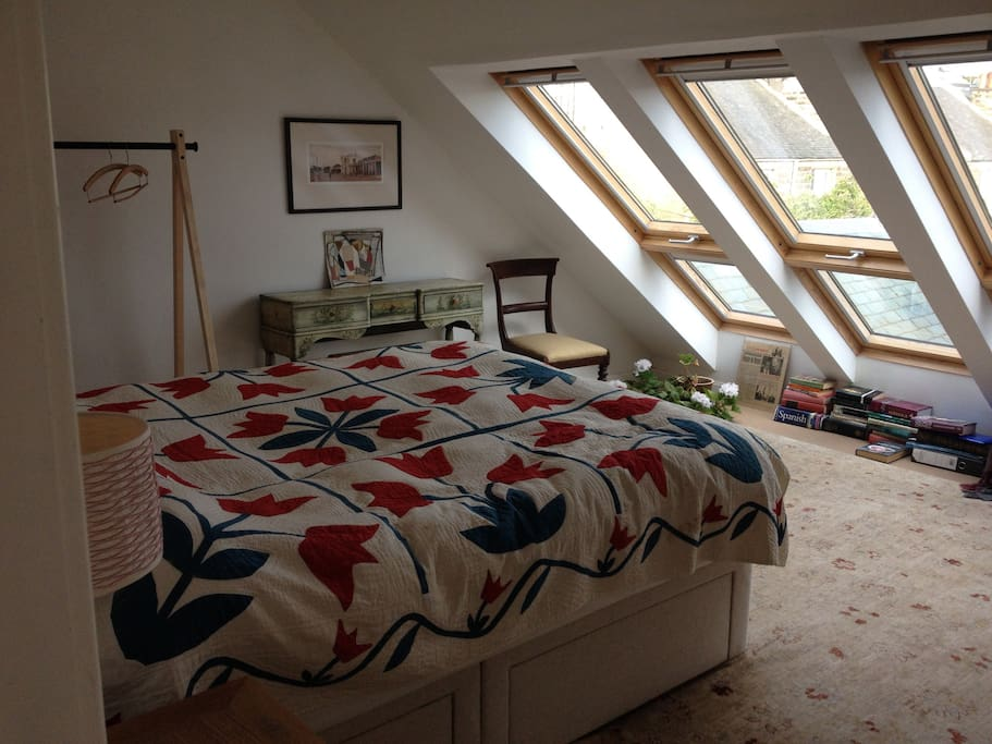Kingsize bed in light airy room with views across garden to the Peatland Hills
