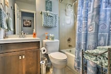 The full bathroom features a shower/tub combo.