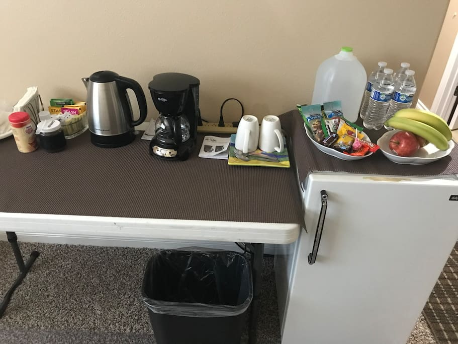Beverage & Snack Bar in Living Room. Included in your stay with Coffee Maker & Coffee, Hot Water Kettle, Tea, Bottled Water, Snacks, Fruit, Cream, Sweeteners, Cups...