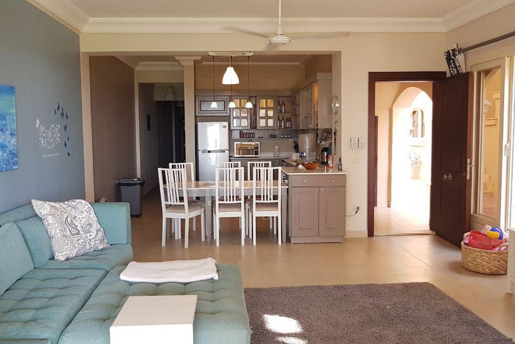 Private entrance into a cozy open kitchen and living space leading to the bedrooms & bathrooms
