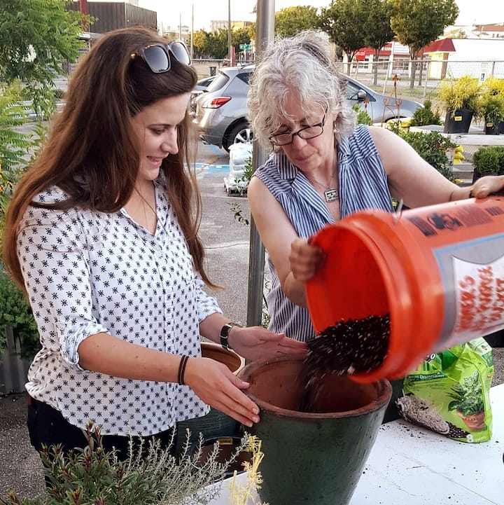 Guests filling pots with soil