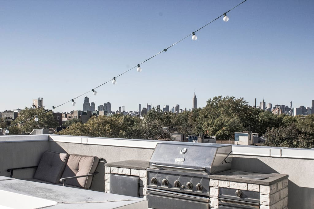 Panoramic view of Manhattan with BBQ and fridge.