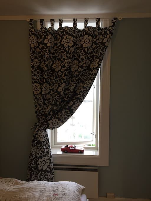 Window with black out curtains