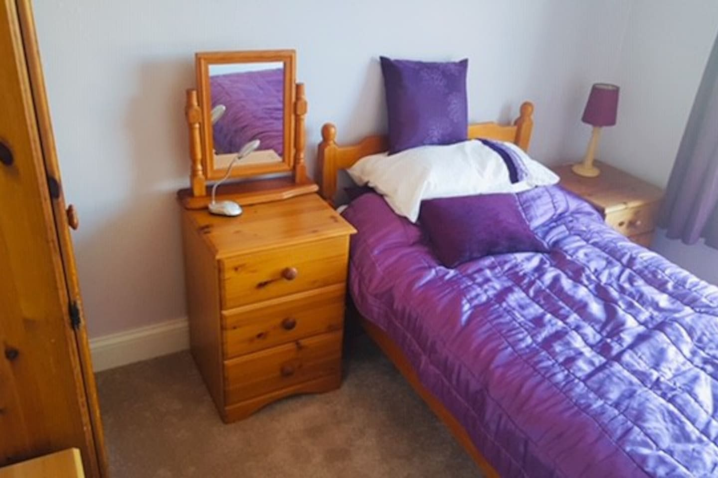 Cosy, newly decorated single room with sea views , pine wardrobe and chests and bedside tables and television.
