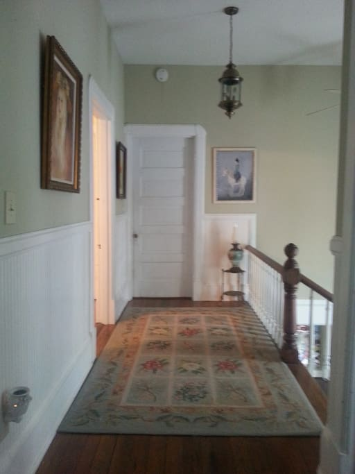 This is the hallway upstairs. Your bedroom is the door on the left...visible when you come up the stairs.