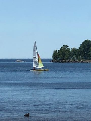 In summer the lake is busy with sailboats, windsurfers, Canoes,  Jet Skies and boats of many colors,,