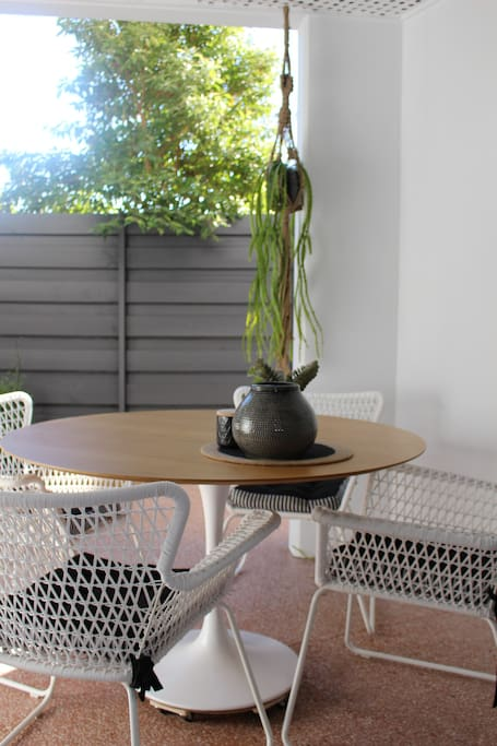 Outdoor dining table on wheels