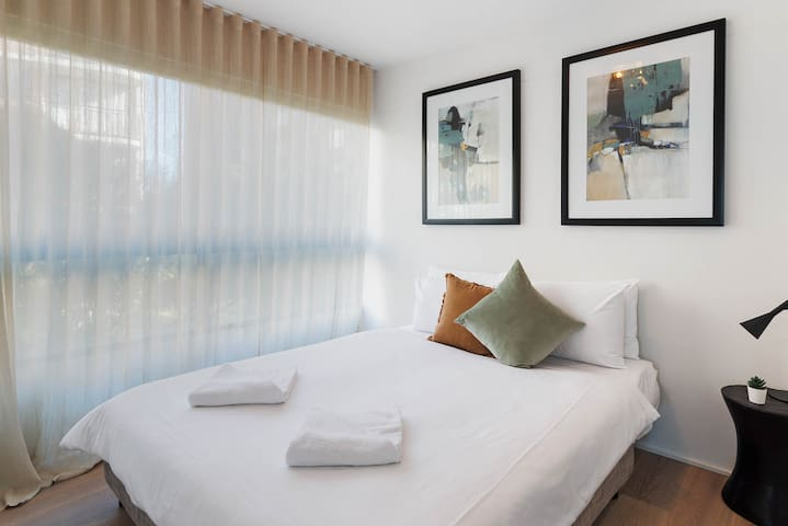 The second bedroom also has a premium queen-sized bed and a spacious wardrobe for storing your belongings.