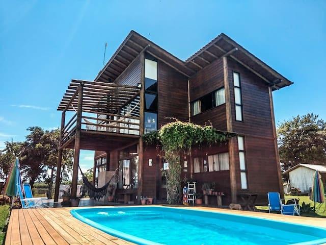 Good Vibes House - Beira da lagoa Ibiraquera qto1