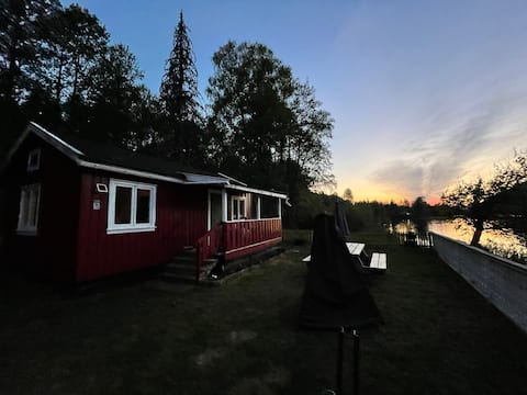 Cozy cottage by the water with motorboat for fishing