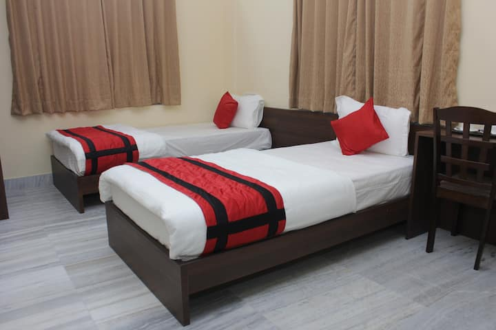Twin bed with attached washroom
