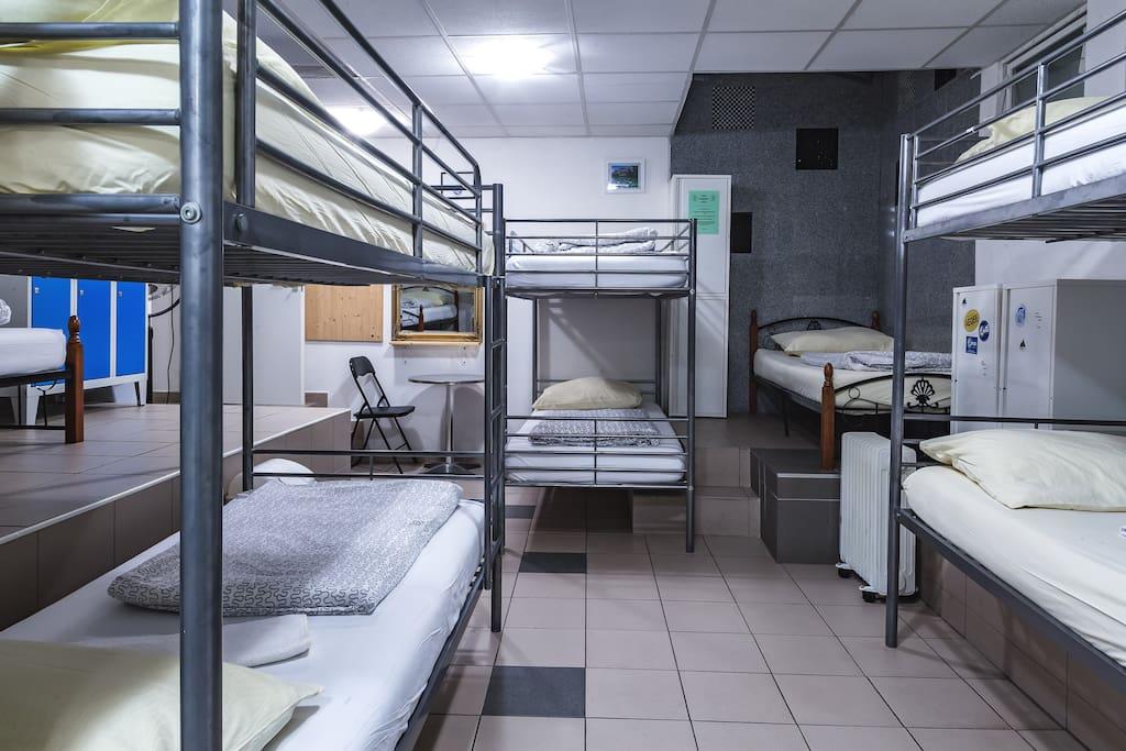 Our dormitory with 12 beds offers you outlets, two bathrooms with showers and lockers for your valuables and some personal space as well!