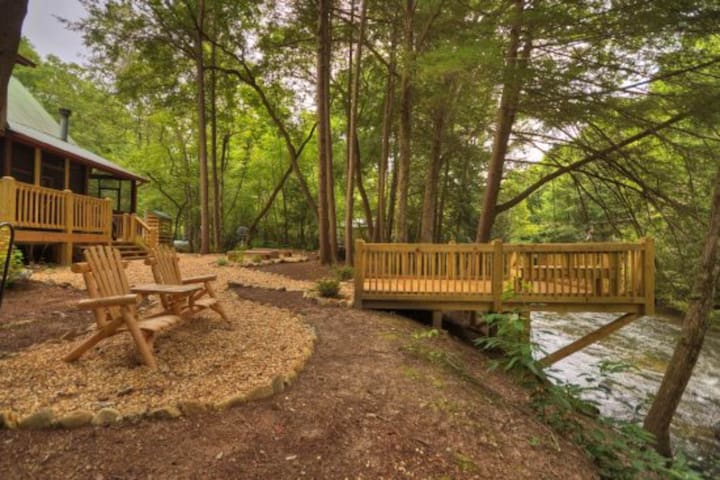 Waterfront creekside cabin features screened porch, private hot tub, & WiFi!