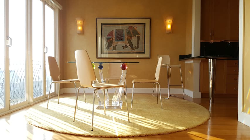 Dining room, adjacent to kitchen and living room, likewise commands the fantastic views.