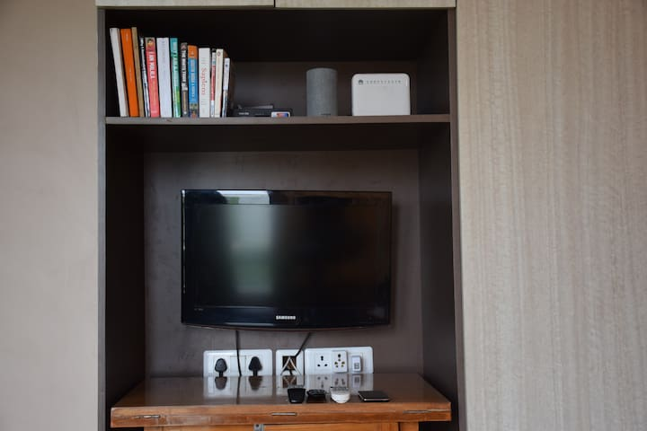 WiFi, TV with Cable, Alexa and smart phone (connected to lights, fans and AC).