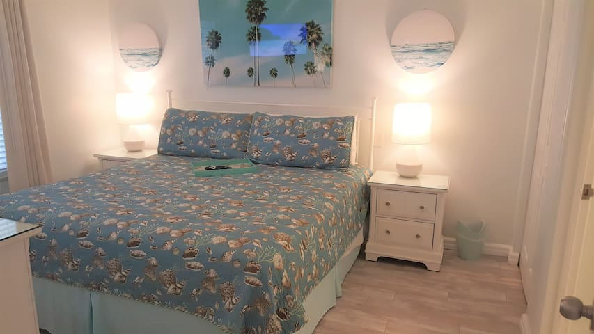 Delightfully decorated, coastal style bedroom with king bed & brand new flooring