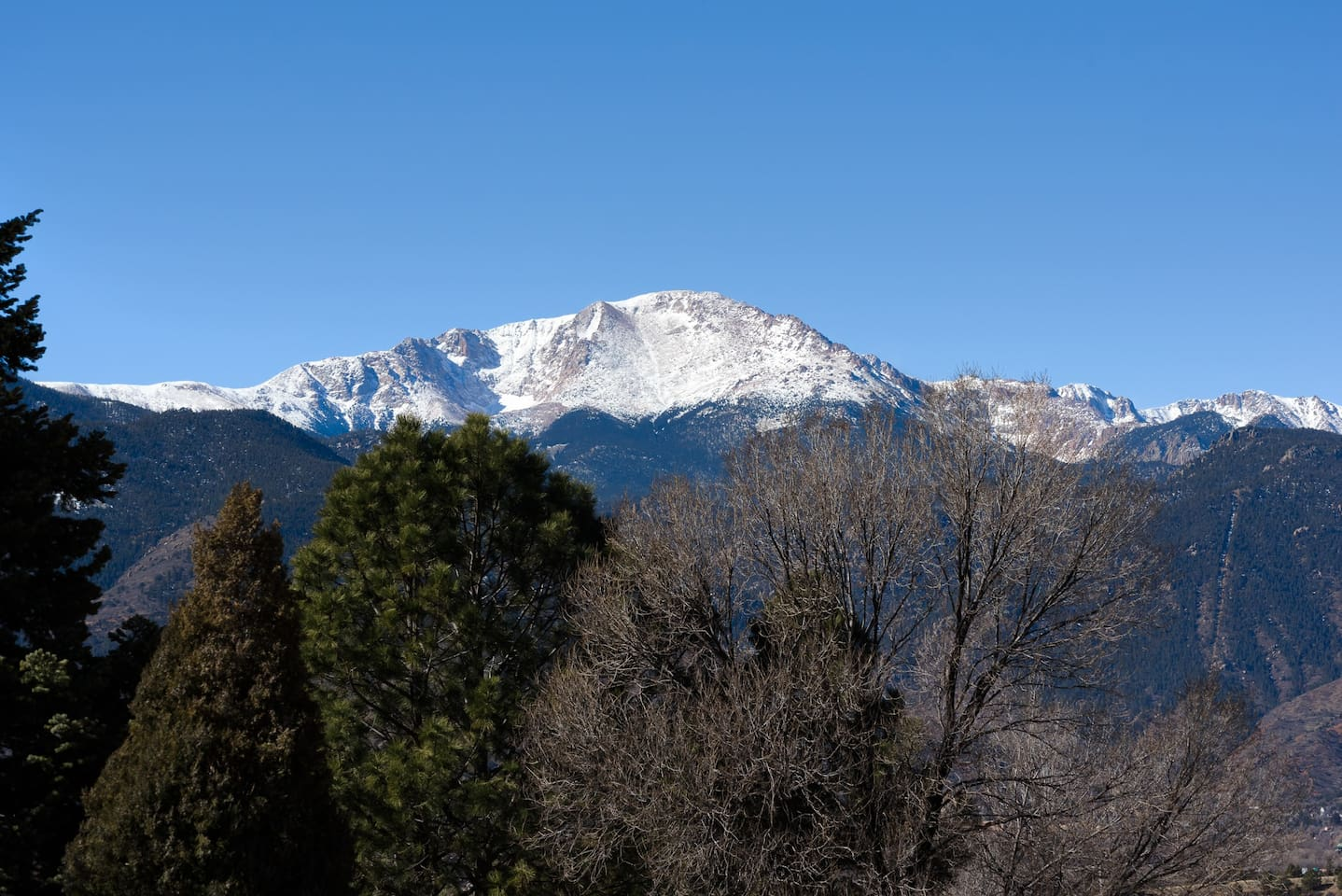 Enjoy a little slice of paradise with a view of Pike's Peak.  This is what you see from the entry deck and living room of Peakview Little Luxury house. Can't beat the view.
