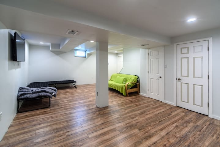 """Finished basement with large 55"""" Smart LED TV that has Roku"""