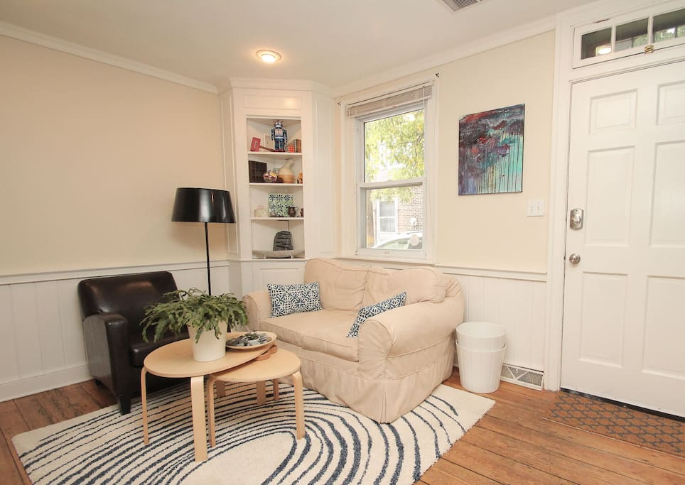 Comfortable living room with Roku/TV and original artwork. Personality and charm sprinkled throughout the home.