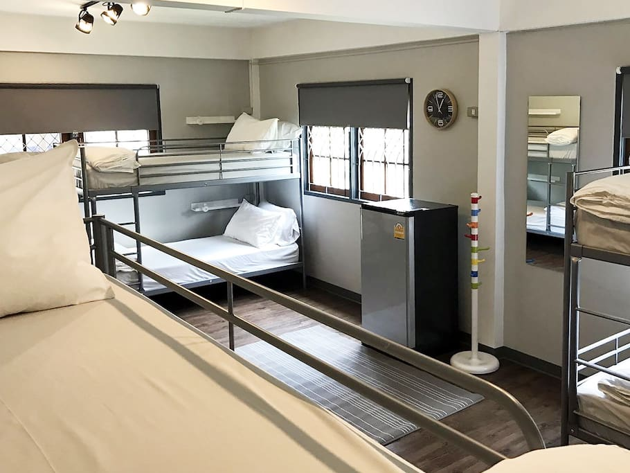 Dormitory room - Clean bedding with hard and soft pillow.