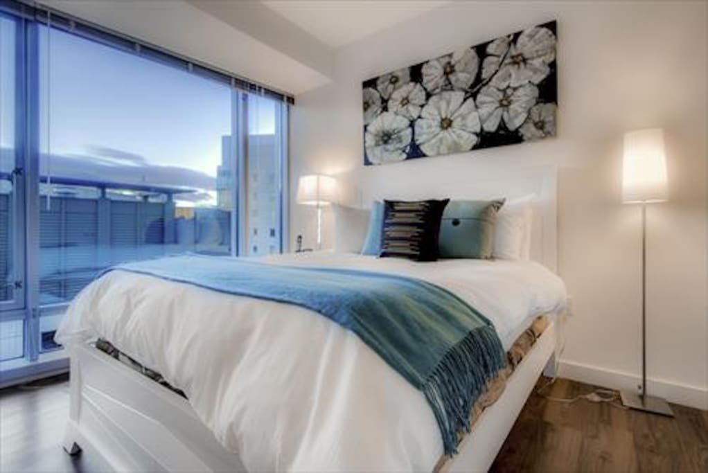 Comfortable bedroom with a queen bed, spacious closet and tons of natural light.