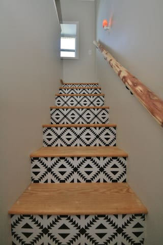 Our property has an abundance of cedar trees and this stair railing was hand carved on site
