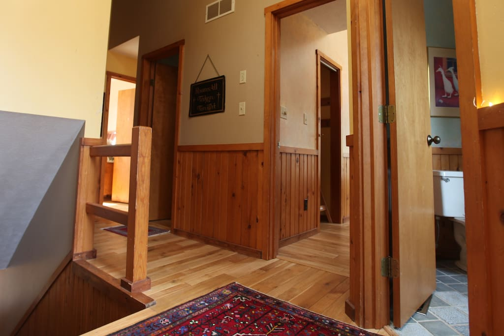 This is the hallway that links the bedrooms, the stairwell and bath.