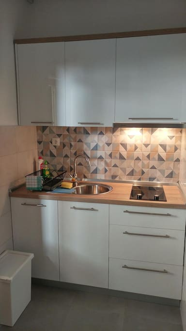 Kitchen with kitchen hood