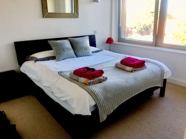 Bedroom 1 with ensuite walk in shower and separate bath and shower,