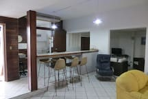 View of the kitchen area and eating counter